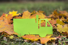 Green paper truck   on an autumn background.Eco friendly Royalty Free Stock Photos