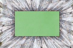 Green Paper on wood Royalty Free Stock Image