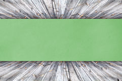 Green Paper on wood Stock Photos