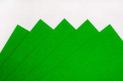 Green papers for origami on the white background Stock Photo