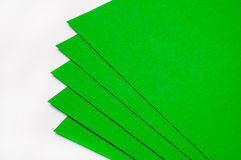 Green papers for origami on the white background Royalty Free Stock Images