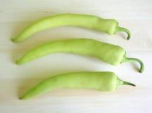 Green paprika. Three green paprika on a desk Stock Image