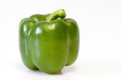 Green Paprika. Close up of a green paprika on white background Royalty Free Stock Photos