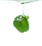 Green paprika in clear water Stock Photos