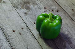 Green paprika on grey wooden background Royalty Free Stock Photos
