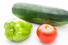 Green paprika pepper, tomato and vegetable marrow Royalty Free Stock Photography