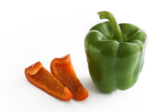 Green Paprika with red slices Stock Photography