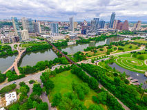 Green Paradise Over Modern Butler Park Capital City Skyline View of Austin Texas. During springtime. After good rain the texas hill country and Austin , texas Royalty Free Stock Photo
