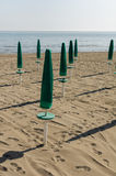 Green parasol on the beach Stock Photos