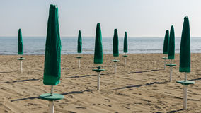 Green parasol on the beach Stock Photography