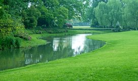 Green park. Green summer park with pond, Hangzhou, China Royalty Free Stock Photography
