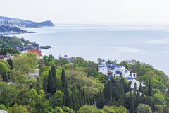 Green park with beautiful villas on the Black Sea. Background landscape view of the green park and the cape with beautiful villas on the Black Sea royalty free stock photography