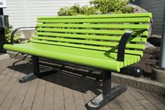 Green park bench. An intense green park bench Royalty Free Stock Images