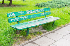 Green park bench Stock Image