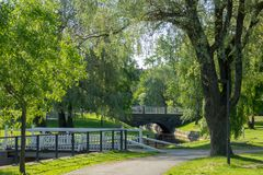 Green park and bridges in Oulu, Finland. Green park with trees, grass and bridges in Oulu, Finland royalty free stock photo
