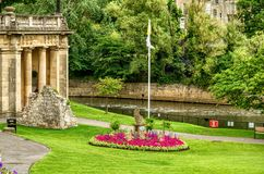 Green park and buildings along River Avon, Bath, England Royalty Free Stock Image