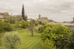 Green park in Edinburgh. Beautiful green park in the center of Edinburgh, with the Scott Monument in the background Stock Photography