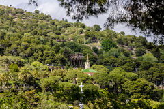 Green park Güell. View on green full of trees and vegetation park Güell in Barcelona Catalonia with people Stock Photos