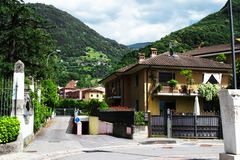 Green park in Italy. Beautiful view of the houses and the street in the Italian city of Pisogne stock image
