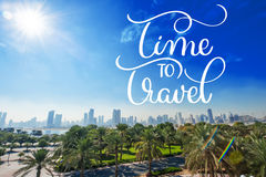 Green park with palm trees on the background of skyscrapers and Time to travel text. Calligraphy lettering hand draw Stock Image