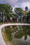 Green park with pond. Vie in park with green trees reflecting in pond. Nice perspective. Shot in Dubrovina park, Daugavpils, Latvia Royalty Free Stock Photography