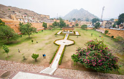 Green park of Rajasthan king under the ancient Amber Fort. Royalty Free Stock Photos