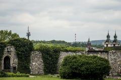 Green park wall skyline Church and radio tower in Krakow Poland Stock Photos