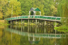 Green park with wooden bridge Royalty Free Stock Photography