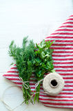 Green parsley and dill leaves on natural linen napkin on wooden background Stock Photo