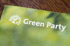 The Green Party. London, UK - May 20th 2019: A close-up of the Green Party logo on an information leaflet.  The Green party is a political party based on the royalty free stock photo