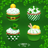 Green party set. Collection with cupcakes for St. Patrick's Day. With gold coins and clovers. Vector illustration. EPS 10 Royalty Free Stock Photo