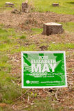 Green Party Sign and Tree Stumps. Campaign sign of Canada's Green Party leader Elizabeth May is shown amongst stumps of Douglas Fir trees in her riding during Royalty Free Stock Photo