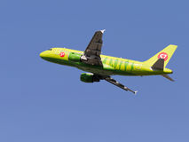 Green passenger aircraft Airbus A319-114, S7 Airlines Stock Photos