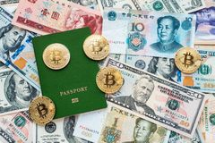 Green passport on background, proof of identity. Against paper money, US dollars, Chinese yuan CNY, metal coins, bitcoin. Green passport on the background, proof Royalty Free Stock Images