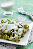 Green pasta with cheese sauce stock photo