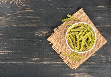 Green pasta fusilli in bowl Stock Images
