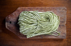 Green pasta on  old wooden table Stock Photography