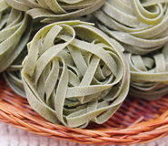 Green pasta. Some italian pasta with spinach stock photos