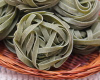 Green pasta. Some uncooked green italian pasta stock image