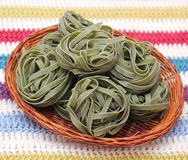 Green pasta. Some uncooked italian green pasta royalty free stock photography