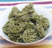 Green pasta. Some uncooked italian green pasta royalty free stock photos