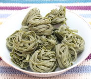 Green pasta. Some uncooked italian green pasta royalty free stock image