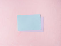 Green pastel card on pink textured background Stock Photo