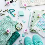 Green pastel lifestyle woman clothes flat lay. Green pastel mint color fashion lifestyle woman clothes flat lay with accessories, notebook and keyboard Royalty Free Stock Photography
