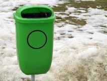 Green pastic garbage bin or can on street Royalty Free Stock Image