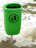 Green pastic garbage bin or can on street Royalty Free Stock Photos