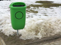Green pastic garbage bin or can on street Royalty Free Stock Photo
