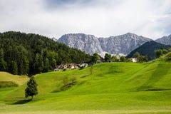 Green pasture in Austria alps near border with Slovenia. Carinthia region royalty free stock image