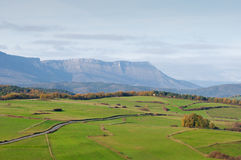 Green pastures and mountains on a spring morning Royalty Free Stock Photo