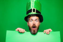 Green patricks background. Man in Saint Patrick`s Day leprechaun party hat having fun on green background. Copy space. Green patricks background. Man in Saint stock photos